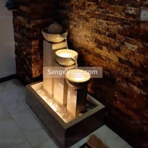 آبنمای سنگی سانیا با سه ستون و نور پردازی در کار