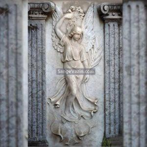 مجسمه فرشته سنگی بر روی نما